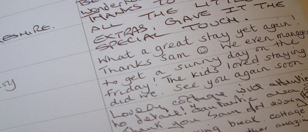 Close up view of the guestbook at Gors-lwyd Cottage Llithfaen
