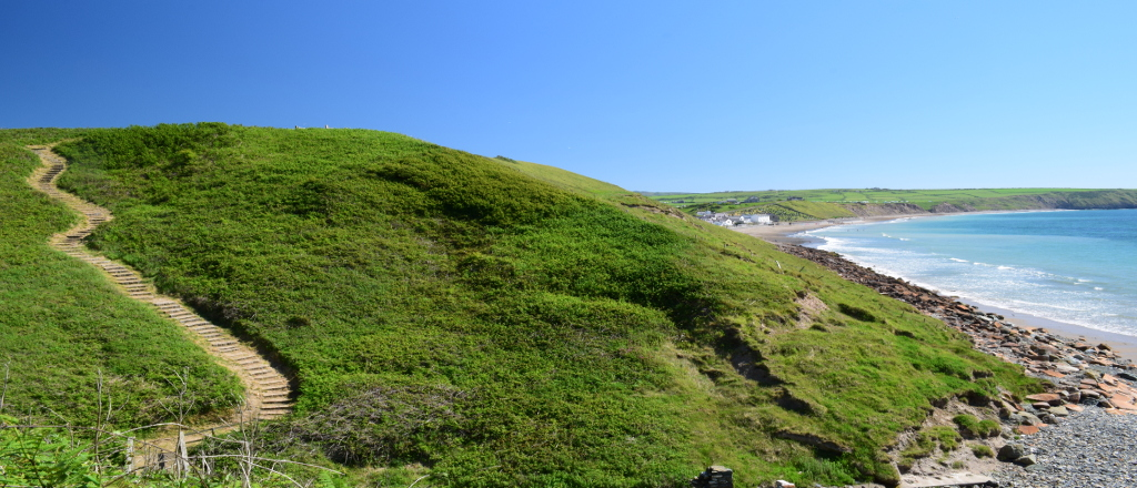 View of Aberdaron from the Wales Coast Path. Path from Aberdaron to Porth Meudwy. Bardsea, Llyn Peninsula, North Wales
