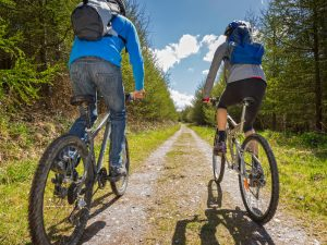 Couple cycling the cycle paths of Llyn Peninsula