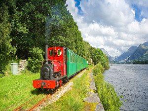 Image of the train running along Lake Padarn Llyn Padarn railway North Wales train trip