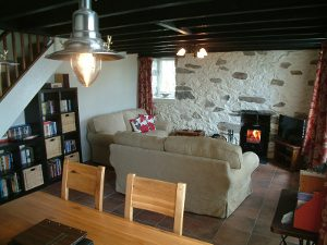 View of the lounge with log burner and dining room Gors-lwyd Cottage Llithfaen Llyn Peninsula