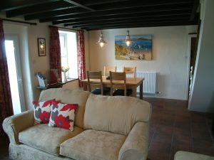 A view of the lounge and dining room at Gors-lwyd Cottage Llithfaen Llyn Peninsula