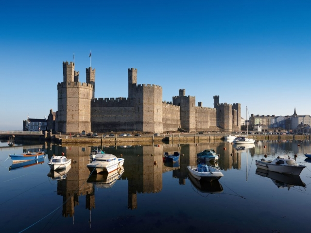 View of Caernarfon Castle from the harbour Caernarfon North Wales