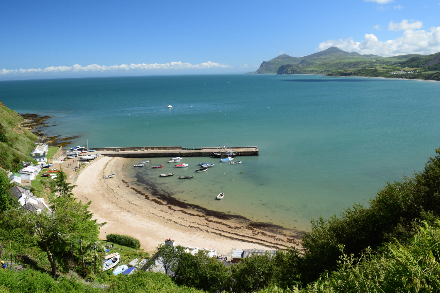 A view of the beach and harbour of Nefyn taken from the wales coastal path