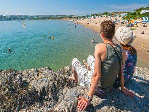 Couple overlooking Abersoch beach Llyn Peninsula North Wales