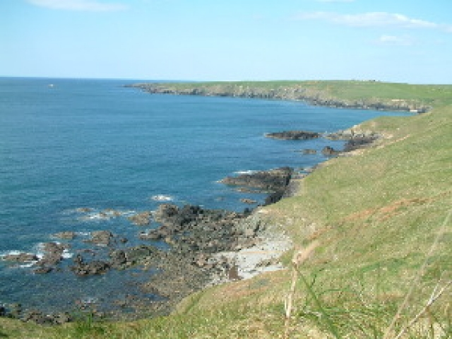 A view of the coastal to Porth Oer Porthor Whistling Sands