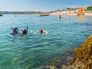 Children snorkelling in the sea at Abersoch Llyn Peninsula North Wales