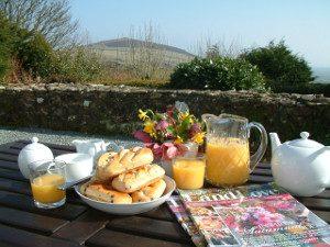 Orange juice tea and breakfast rolls outside Gors-lwyd Cottage Llithfaen Llyn Peninsula
