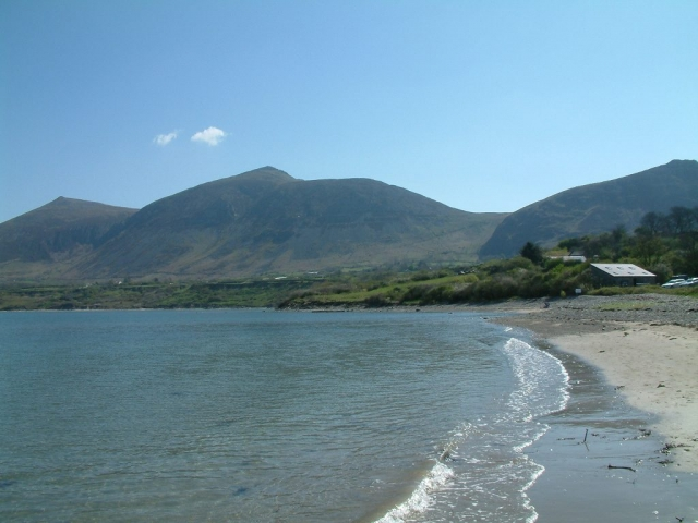 A view of the beach at Trefor with mountains Llŷn Peninsula