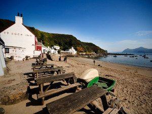 View of the beach and Ty Coch Inn Porthdinllaen Llyn Peninsula Morfa Nefyn North Wales