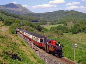 Steam train at the Vale of Ffestiniog narrow gauge track North Wales