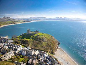 Aerial shot of Criccieth Castle and beach Llyn Peninsula North Wales