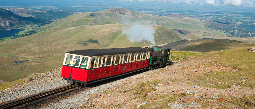 A view of a steam train to the summit of Mount Snowdon narow gauge railway