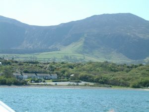 View of Trefor beach from the sea Llyn Peninsula North Wales boating fishing