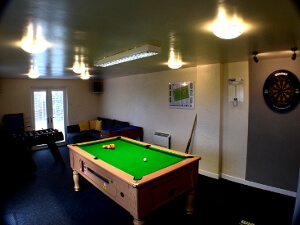 Image of Gors-lŵyd games room with pool table, dart board and foosball table