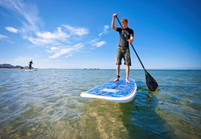 Young man paddleboarding in North wales
