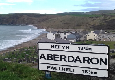 View of Aberdaron village including road sign.